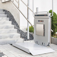 Outdoor Ascendor Platform Lift raises a wheelchair.