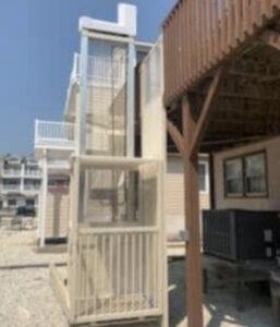Crown Elevator Vertical Platform Lift in powder coated almond